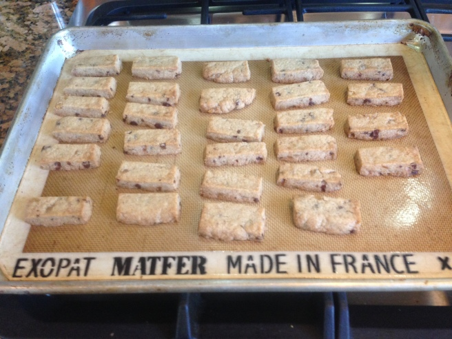 completed shortbread finger cookies on a baking sheet with silpat